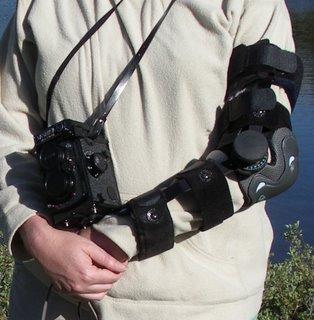 Arlene wearing arm brace, shoulder pad, and camera