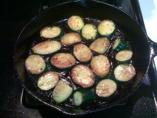 zucchini slices frying in olive oil