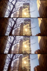 four panoramic images of downtown building reflecting the sun
