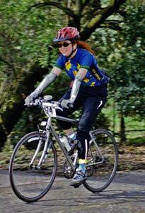 souvenir photograph of Arlene riding her bicycle at the 2006 Cinderella Classic