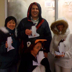 Halloween group of Antarctic researchers with local penguins