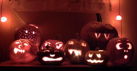 group photograph of carved jack-o-lanterns