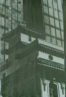 deep green gum bichromate image of building with elaborate Chinese tile roof