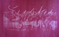 red gum bichromate print of neon sign reading sushi open