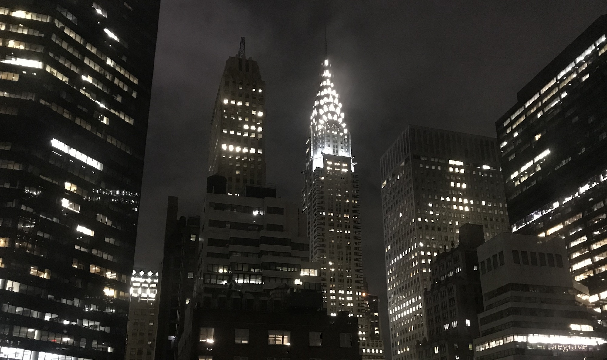 photo of the NYC skyline at night by A.E. Graves