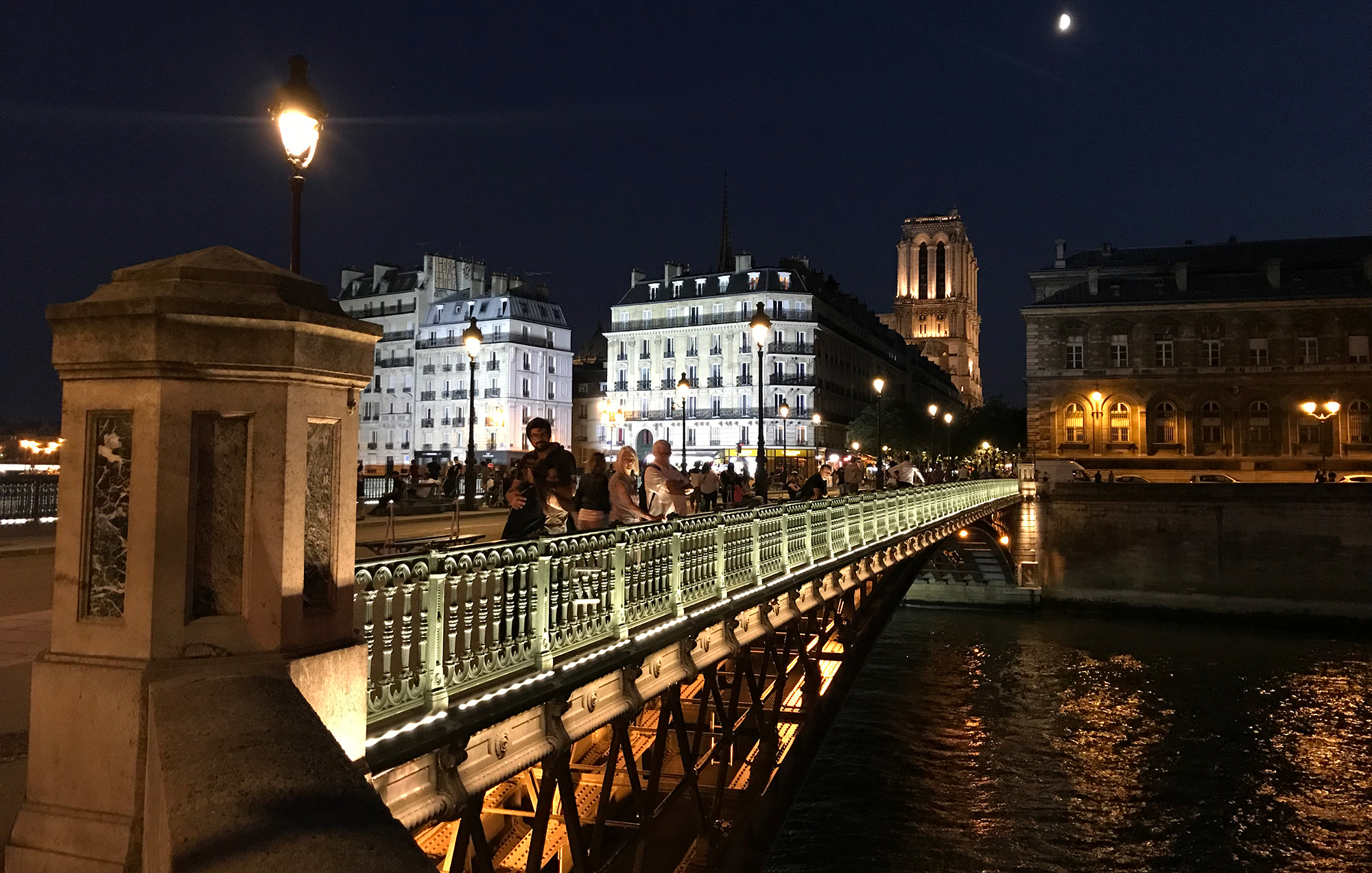 photo of a bridge over the Seine in Paris, France in the evening by A.E. Graves